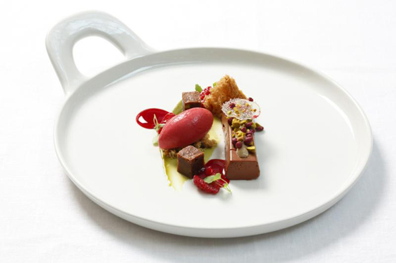 Chocolate bavaroise tasted with Dilmah Earl Grey, variation of raspberries & tea served with pistachio